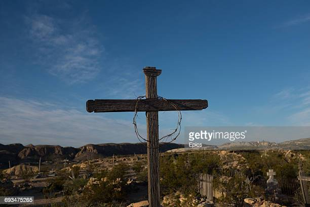 A cross marks a grave in the cemetery of the ghost town Terlingua Texas the cemetery dates from the early 1900's and was the final resting place for...
