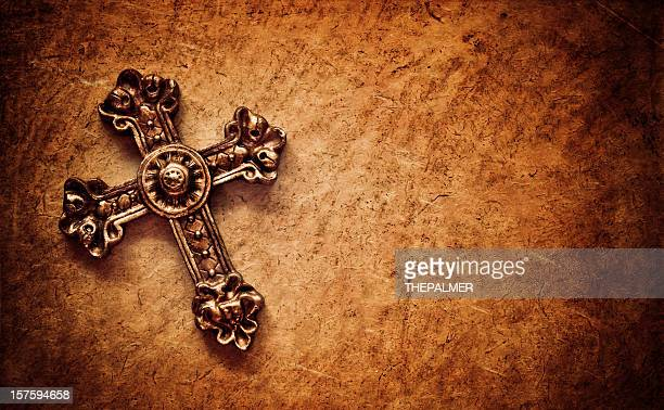 cross on brown paper background