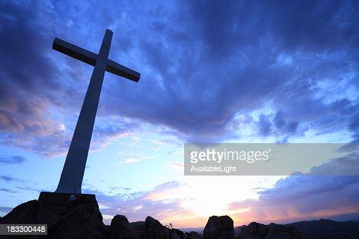 Cross on Hill at Sunrise