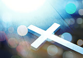 Cross on wood and bokeh background