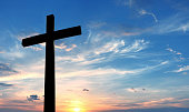 Christian cross over beautiful sky background concept of religion