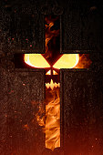 Cross in fire. Halloween theme.