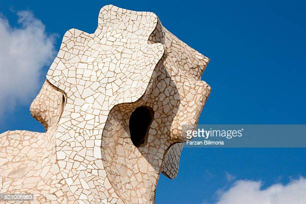 Cross portal window with white mosaic tiles on the roof at La Pedrera Barcelona