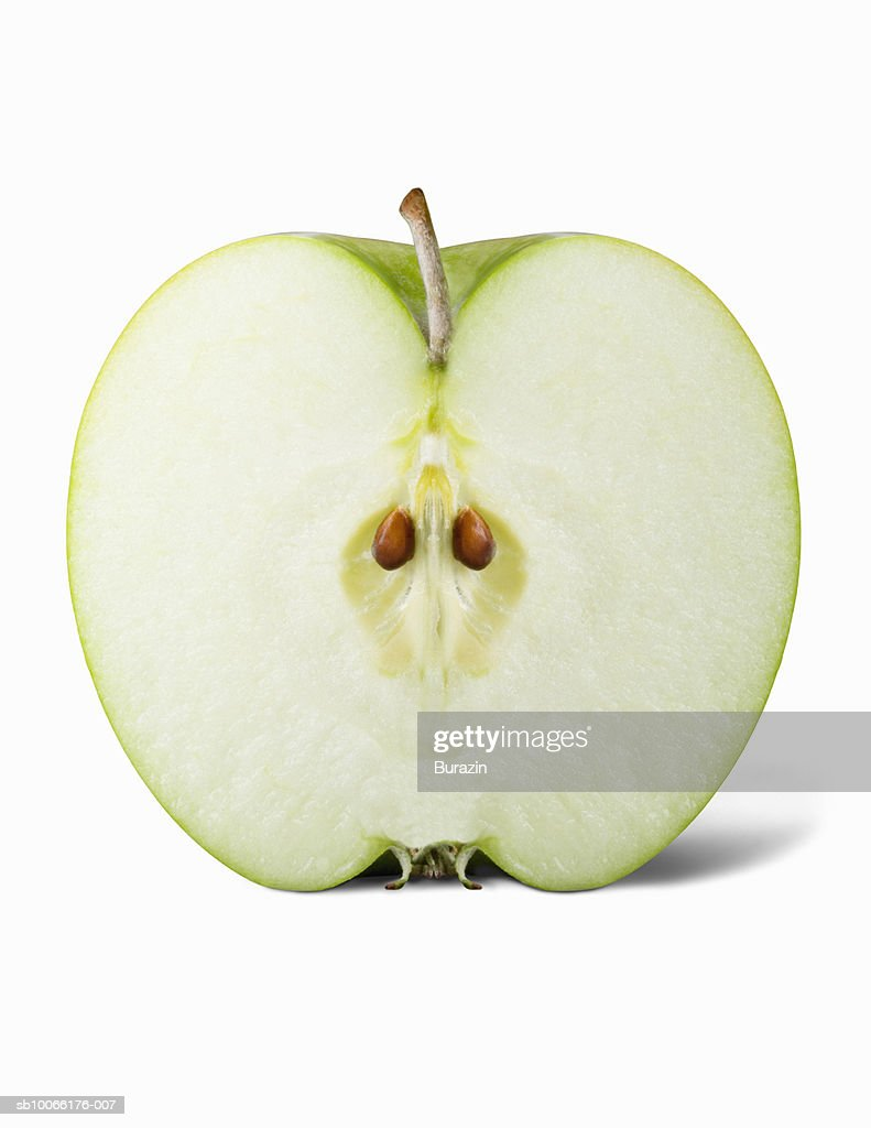 Cross section of granny smith apple on white background : Stock Photo