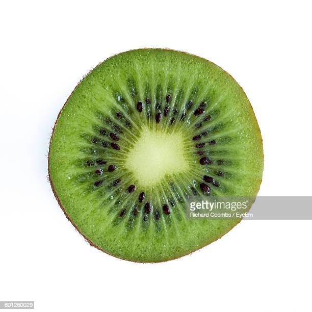 Cross Section Of Kiwi Against White Background