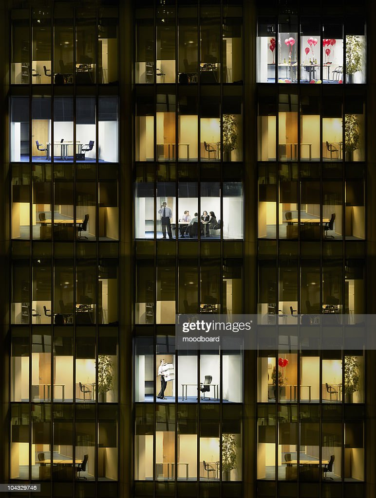 Cross section of office block with people working, view from building exterior (full frame) : Stock Photo