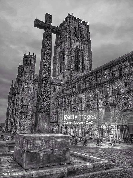 Cross Shape By Durham Cathedral Against Cloudy Sky