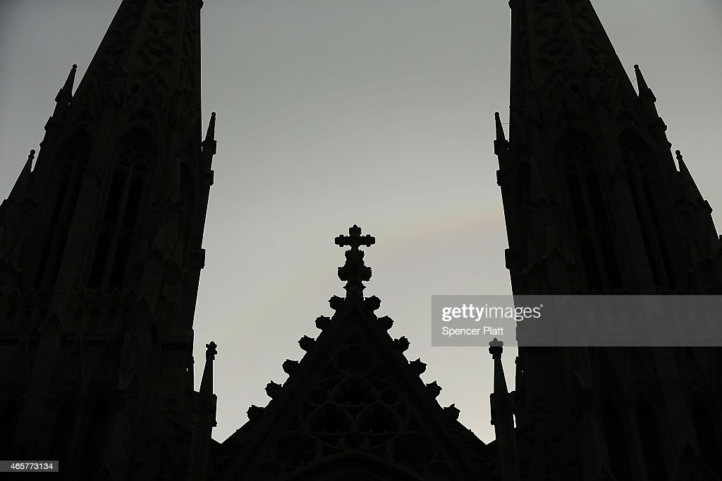 A cross stands above St Patrick's Cathedral as the body of Cardinal Edward M Egan lies in state during a public viewing at St Patrick's Cathedral on...