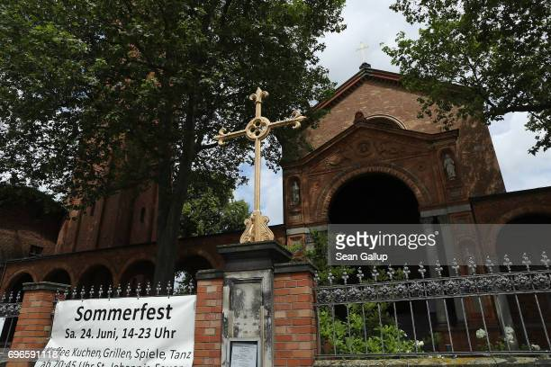 A cross stands outside the St Johanneskirche church which is also home to the new IbnRushdGoethe Mosque on June 16 2017 in Berlin Germany The new...