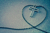 silver cross symbol in love shape image