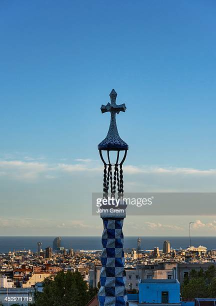 LA SALUT BARCELONA CATALONIA SPAIN Cross tower in Park Guell overlloking the city