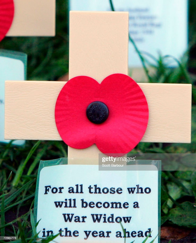 A cross with 'For all those who will become a War Widow in the year ahead' written on it sits in the Field of Remembrance at Westminster Abbey on November 11, 2004 in London, England. The Armistice Day service was held to remember the servicemen and women who died fighting for Britain in war. People across the country and the Commonwealth observed a two-minute silence to remember them.