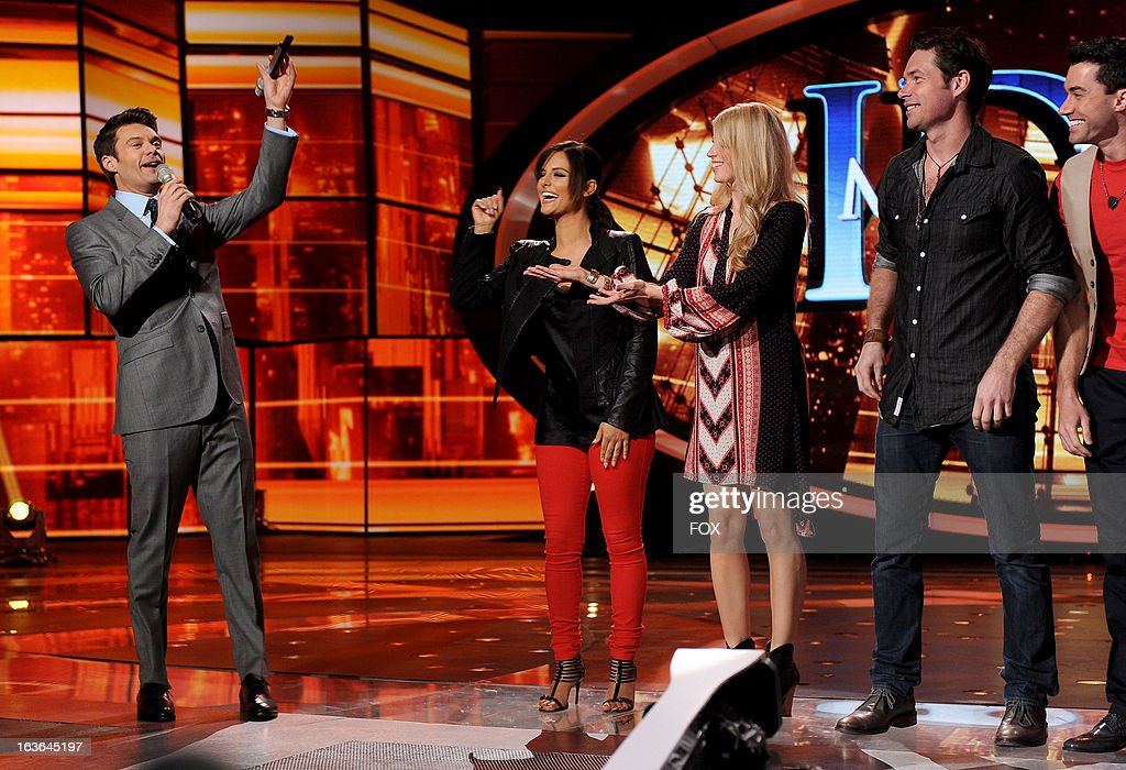 A cross-country relay of the IDOL microphone, starting in New York City finishes it's journey as past and present IDOLS hand it over on the AMERICAN IDOL stage. (L-R) Host Ryan Seacrest, Pia Toscano, Brooke White, Michael Johns and Ace Young onstage at FOX's American Idol Season 12 Top 10 Live Performance Show on March 13, 2013 in Hollywood, California.