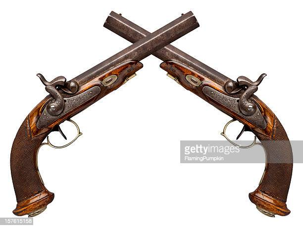 Crossed Antique Pistols Isolated on White.