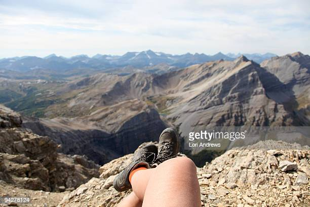 Crossed legs on top of the mountain