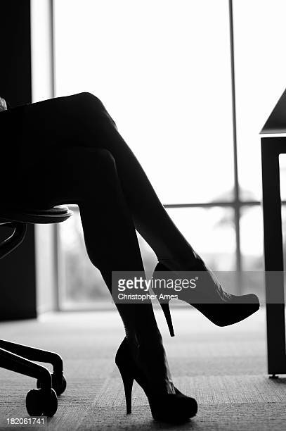 Crossed legs with high heels in the office