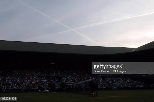 Crossed lines left by airoplanes over Centre Court in the pattern of the Saltaire during the match between Scotland's Andy Murray and USA's Andy...