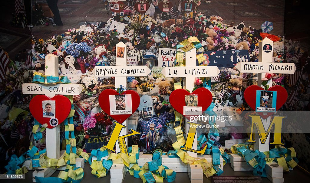 Crosses bearing the names of people killed are displayed in an exhibit titled, 'Dear Boston: Messages from the Marathon Memorial' in the Boston Public Library to commemorate the 2013 Boston Maraton bombings, on April 14, 2014 in Boston, Massachusetts. Last year, two pressure cooker bombs killed three and injured an estimated 264 others during the Boston marathon, on April 15, 2013.