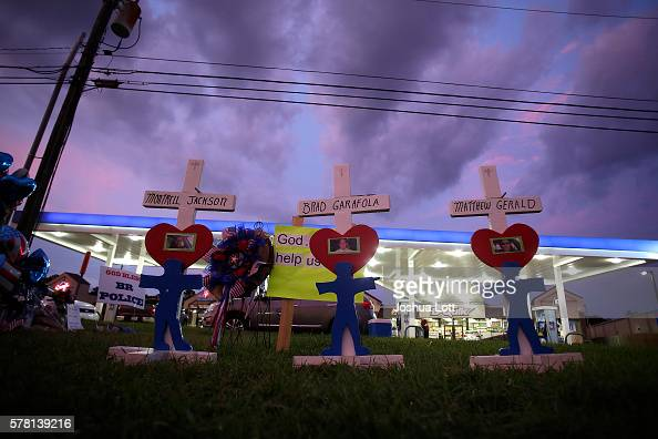 Crosses for Baton Rouge Police Officers Montrell Jackson Matthew Gerald and East Baton Rouge Parish Sheriff Deputy Brad Garafola are displayed at a...