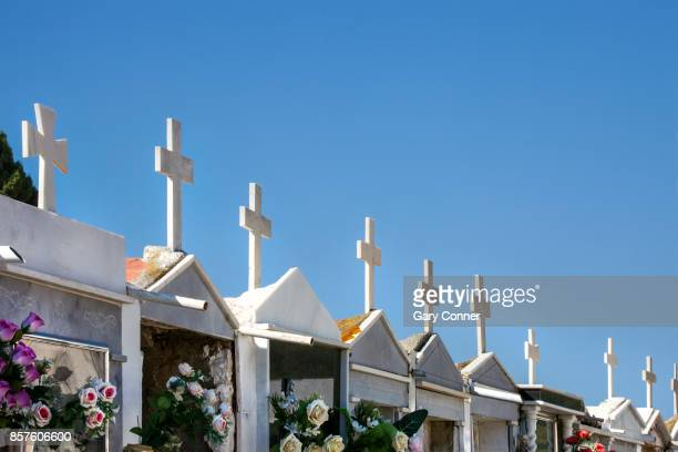 Crosses on crypts at cemetery