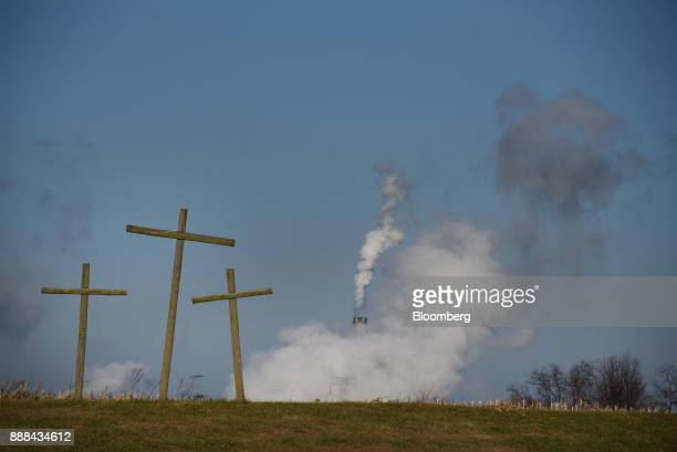 Crosses stand at the edge of a cornfield as steam billows from the FirstEnergy Corp Bruce Mansfield coalfired power plant in Shippingport...