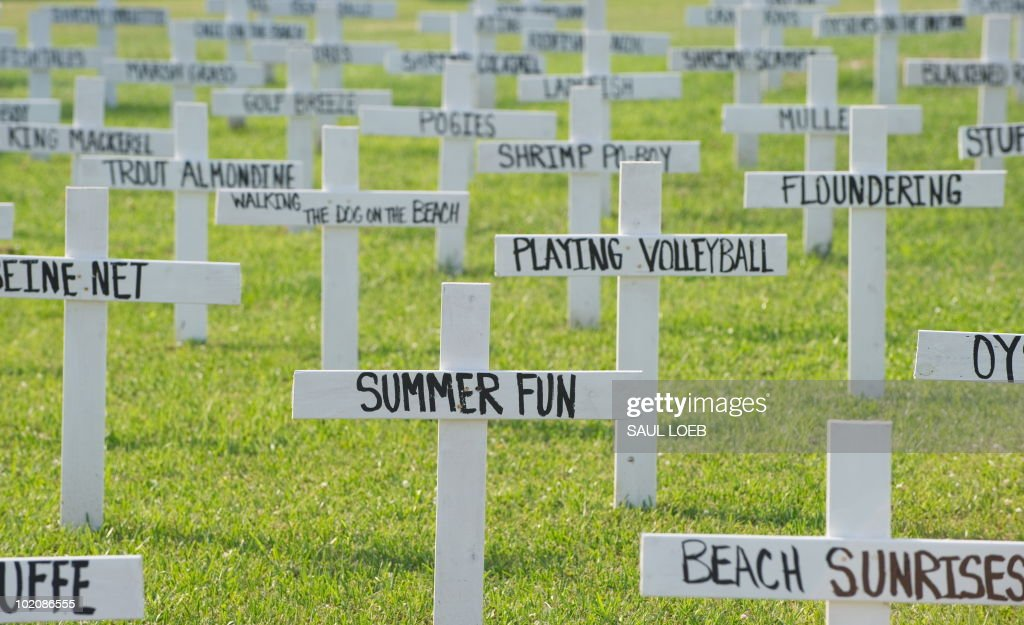 Crosses with descriptions of fish, wildlife and summer pastimes are displayed in a front yard of a home in Grand Isle, Louisiana, June 14, 2010, of things potentially lost to the BP Deepwater Horizon oil spill. AFP PHOTO / Saul LOEB