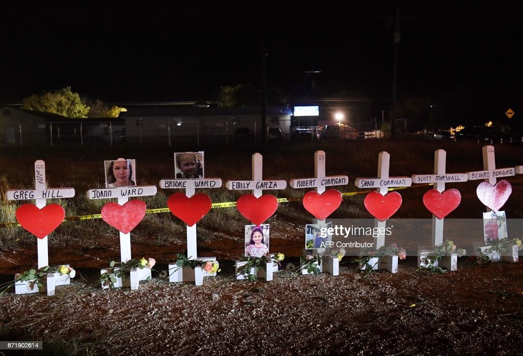 TOPSHOT - Crosses with the names of victims are seen outside the First Baptist Church which was the scene of the mass shooting that killed 26 people in Sutherland Springs, Texas on November 8, 2017. Willeford shot suspect Devin Patrick Kelley, a gunman wearing all black armed with an assault rifle that opened fire on a small-town Texas church during Sunday morning services, on November 5, killing 26 people and wounding 20 more in the last mass shooting to shock the United States. /