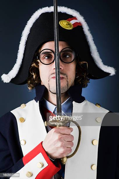 Cross-eyed french soldier dressed like Napoleon.