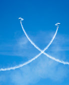 Crossing airplanes at airshow.