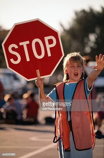 Crossing Guard Holding a Stop Sign