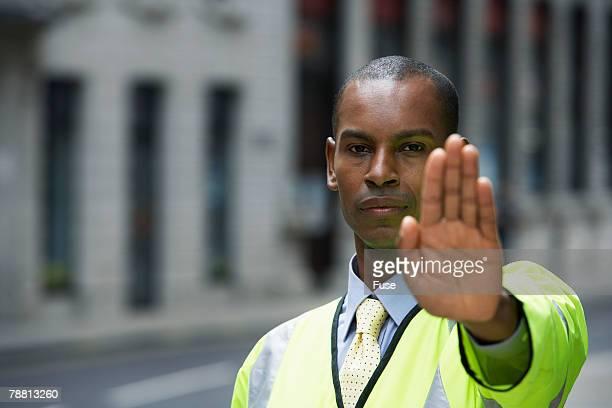 Crossing Guard Raising Hand