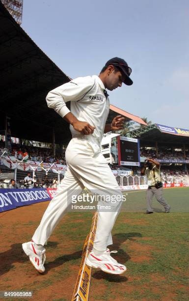 Crossing it for the hundred times Indian Captain Rahul Dravid entering the field for the 100 test matches at India Vs England third Cricket test...