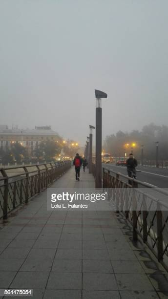 Crossing San Telmo bridge in a foggy day