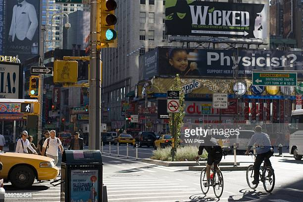 Crossing streets in Midtown West Theater District on Broadway Street at the height of 50th Street In one of the floors above the mall is a jazz...