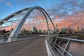 Walking across the Walterdale Bridge in Edmonton towards downtown at sunset.