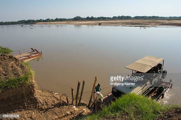 Crossing the Luangwa River by manpowered pontoon ferry in order to enter South Luangwa National Park in eastern Zambia