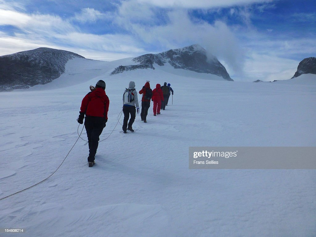 Crossing the Styggebreen glacier to Galdhøpiggen : Stock Photo