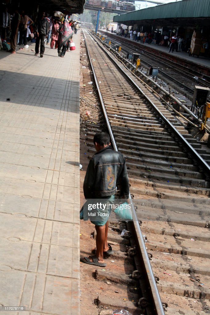 Crossing Tracks and Wrong Sitting Habits of people at entrance of Compartments by Commuters/Passengers with Lack of Concern of Indian Railways make people pay with their lives at almost on all Railway Station in India, at New Delhi Railway Station on June 20,2011.