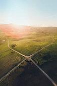 A crossroad between 4 roads in a rural area