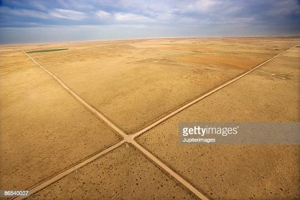 Crossroads through deserted landscape