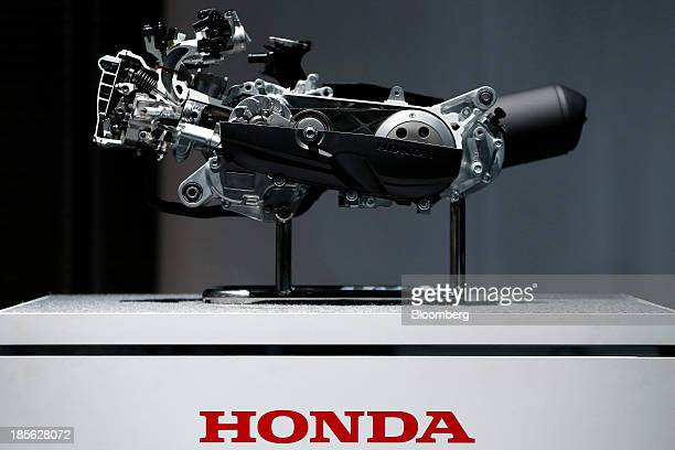 A crosssection model of the watercooled engine for the Honda Motor Co Dunk scooter is displayed at a media event in Tokyo Japan on Wednesday Oct 16...