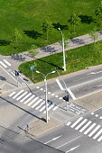 Aerial view of crosswalk and bike crossing line on empty crossroad, driverless technology concept