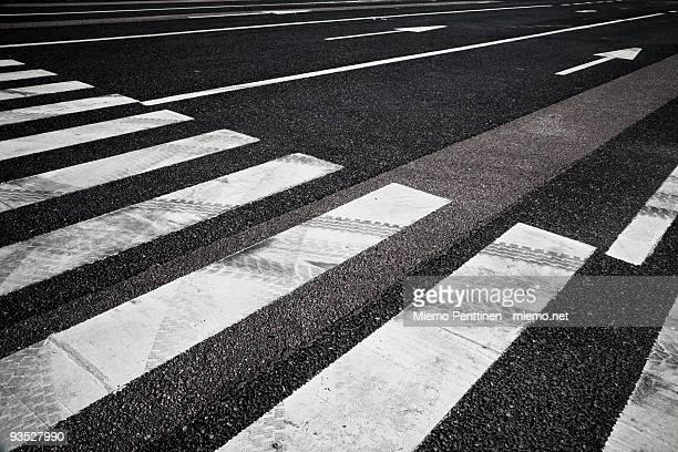 Crosswalk and lane markings on asphalt