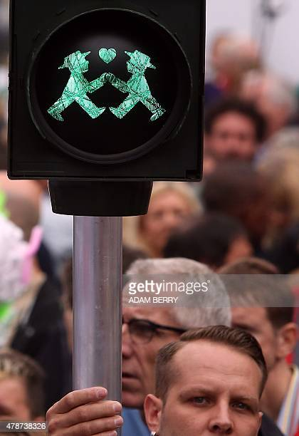 A crosswalk light with two homosexual crosswalk men is seen during the Christopher Street Day gay parade in Berlin on June 27 2015 AFP PHOTO / ADAM...