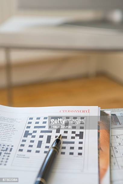 Crossword and pen