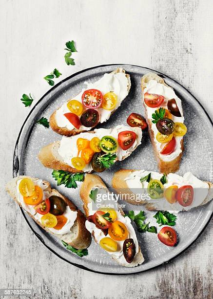 Crostini with fresh tomatoes on a platter