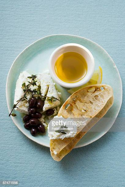 Crostini with sheep's cheese, olives, thyme and olive oil
