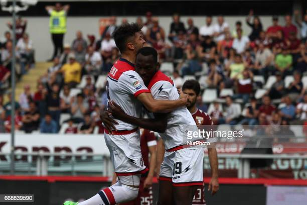Crotone forward Simy celebrates with Crotone midfielder Andrea Nalini scoring his goal during the Serie A match between FC Torino and FC Crotone at...