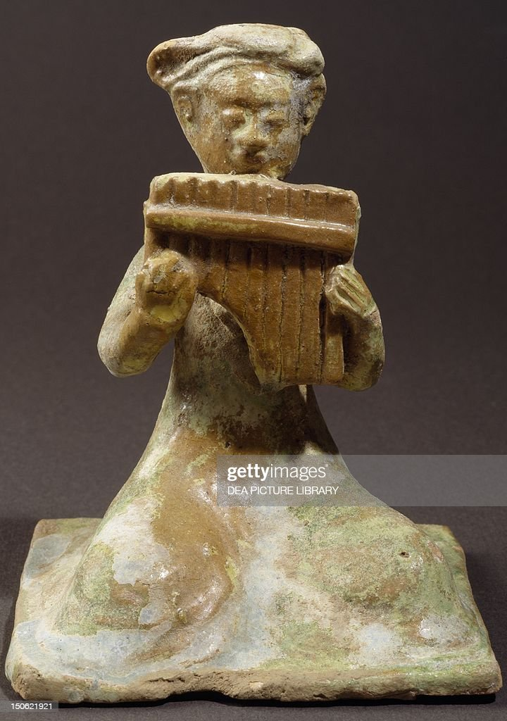Crouching flutist glazed terracotta statue height 14 cm China Chinese Civilisation Sui Dynasty 6th7th century