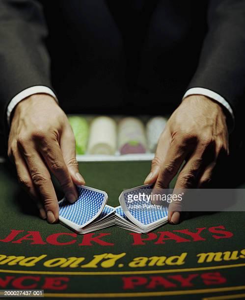 Croupier shuffling cards, close-up
